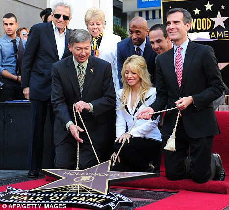 Look, Mum, you were right! Shakira is joined by her parents as her star - the 2,454th on the street - is unveiled