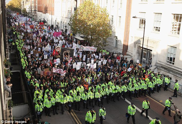 Anger: Young protesters march through central London headed for the City as they demonstrate against tuition fees