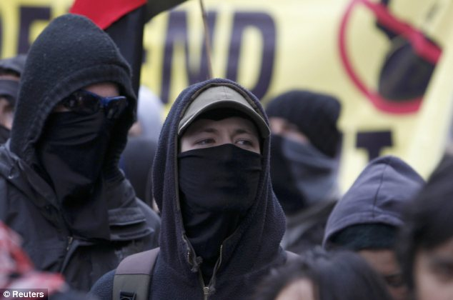 Masked: Many protesters are believed to have come from the Occupy London camp outside St Paul's Cathedral
