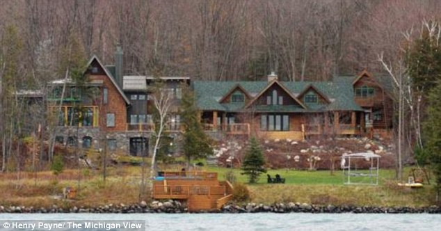 Pricey: Michael Moore's sprawling second home on Torch Lake, Michigan has been valued at around $2 million
