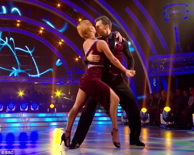 Sizzling: Harry Judd performs an electric performance with Aliona Vilani that left him top of the leader board on Strictly Come Dancing