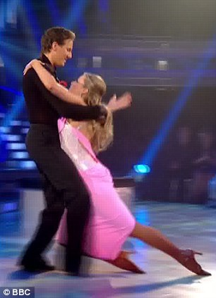 Dramatic: Holly looked more like an ice queen on the rink as she was dragged around in her pink dress
