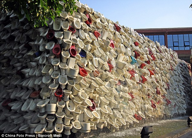 Great tower of toilets: The incredible waterfall was created using 10,000 toilets and washbowls in Foshan, Guangdong Province, China