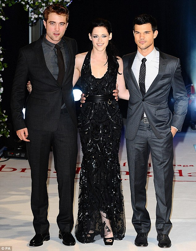 Twilight trio: Pattinson, who plays Edward Cullen and Stewart, who plays Bella Swan pose with Cullen's rival Jacob Black, played by Taylor Lautner