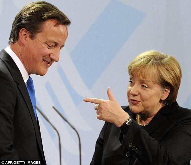 Loggerheads: Despite this show of apparent friendliness, David Cameron and Angela Merkel made no progress yesterday