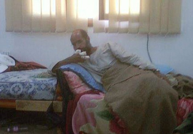 Arrested: Saif al-Islam pictured after his detention in the southern desert of Libya