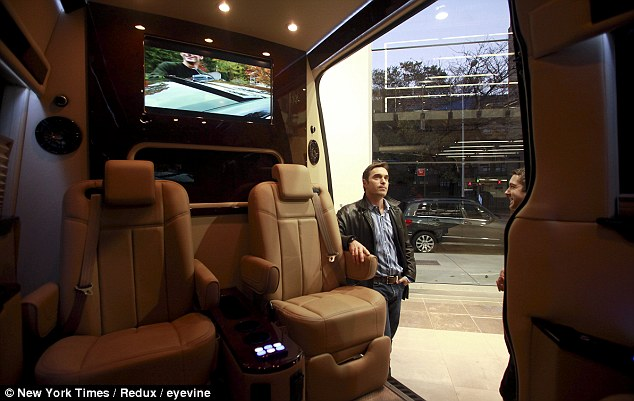 Upgrade: Martin Brass, a former Wall Street exec turned investor, looks at a Mercedes-Benz Sprinter at its New York dealership. There is a growing trend for the city's richest to turn vans into offices or lounges