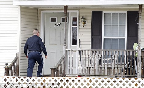 House: A Lakehurst police officer enters a home on Maple Street in Lakehurst where Imani Benton, 24, lives, after her daughter was found dead