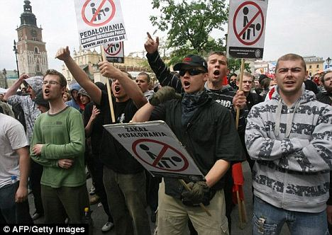 Homophobic: Polish far-right activists wave placards denouncing homosexuality during a protest in 2009. Polish gay rights campaigners have slammed a court ruling allowing a group to formally register a homophobic symbol its logo