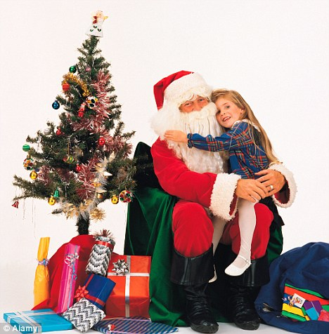 Thing of the past: The scene of children sitting on Santa's knee could be over after government guidance suggested there should be no physical contact between Father Christmas and children.
