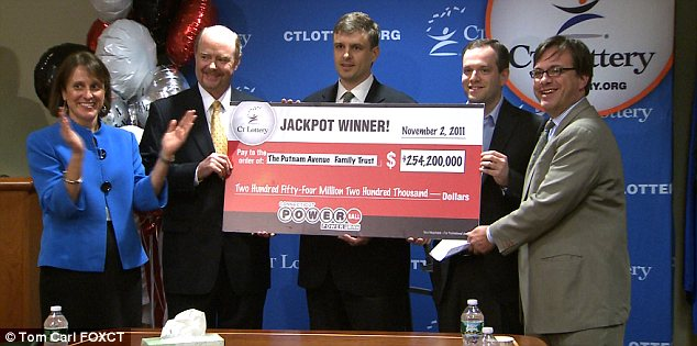 Big win: The trio poses with Anne M. Noble, CT Lottery President and CEO (left) and Frank Farricker after claiming their prize in Rocky Hill, Connecticut