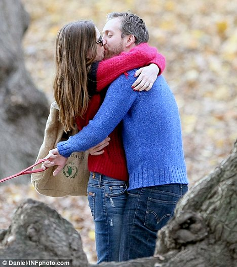 He's my man: The actress couldn't keep her hands off her husband-to-be and was seen passionately kissing him mid-way through their stroll