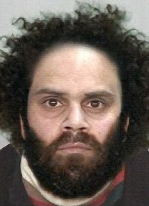 Wanted: Naden with his distinctive hair and heavy beard in a police mugshot