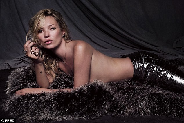 Furry nice: Kate Moss strips off and goes topless with just a rug to protect her modesty as she model her new jewellery collection for French company Fred