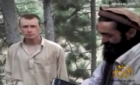 Bowe Bergdahl, left, appeared without beard despite captors' claim he has converted to Islam in the latest video released by the Taliban last May