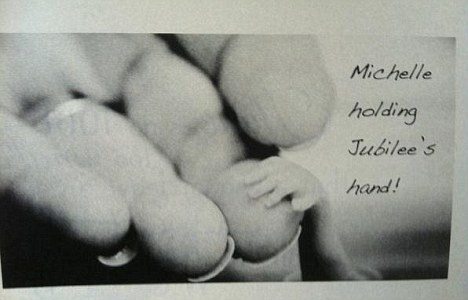 Heartbreaking: A family member posted this picture of Michelle with her late daughter's tiny hand