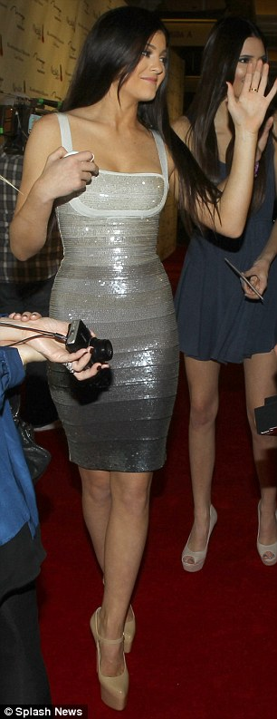 10 years older: Kylie Jenner looked much older than her 14 years last night as she attended the launch of the Kardashian Khaos store in Las Vegas wearing a Hervé Léger bandage dress