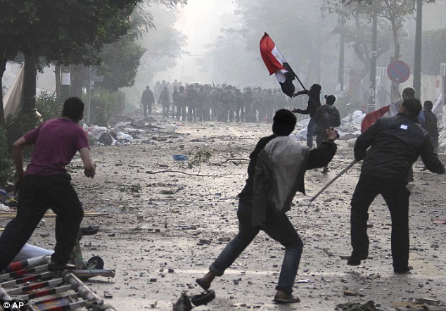 Missiles: Activists throw rocks and firebombs at military police, while one waves a national flag