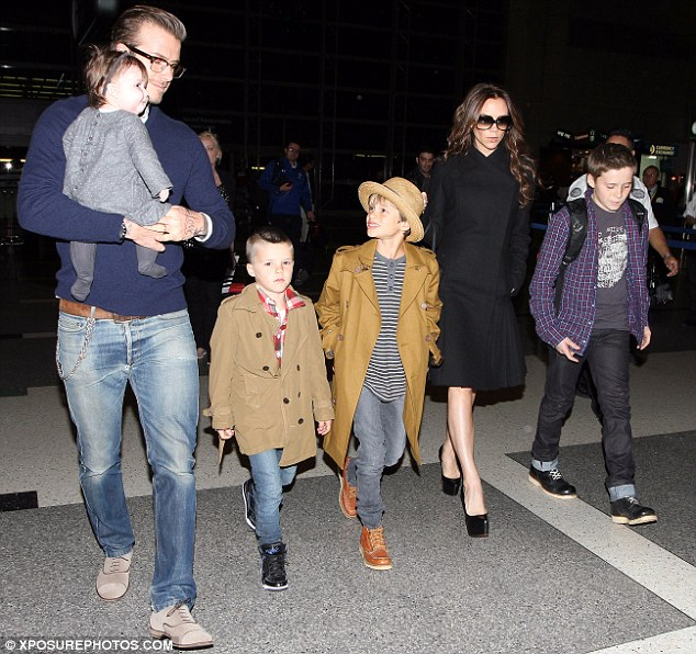 How are you doing? Romeo looks up adoringly at his little sister as the clan make their way through the airport