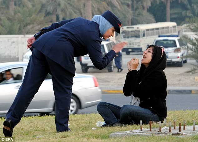 Detained: Activist Zainab al-Khawaja (Right) screams while being arrested during a protest in Abu Seba village, north of Manama
