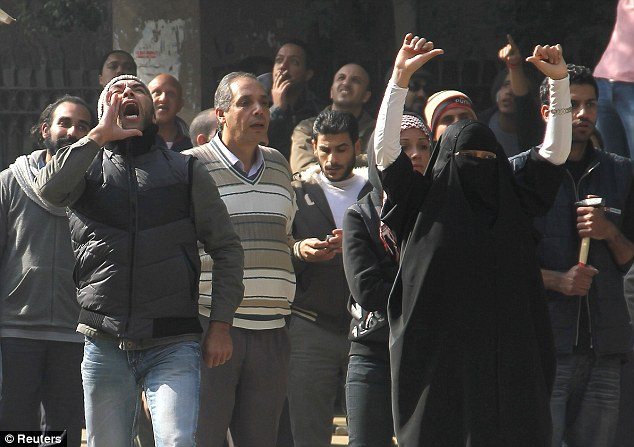 Brave: Two women join protesters as they shout anti-military council slogans near the cabinet in Cairo