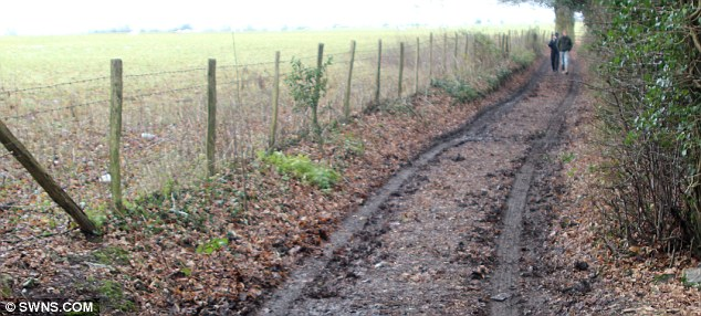 Twisted: Police believe the driver took the Land Rover Discovery in the dead of night into the field along this muddy bridleway before rampaging across the field