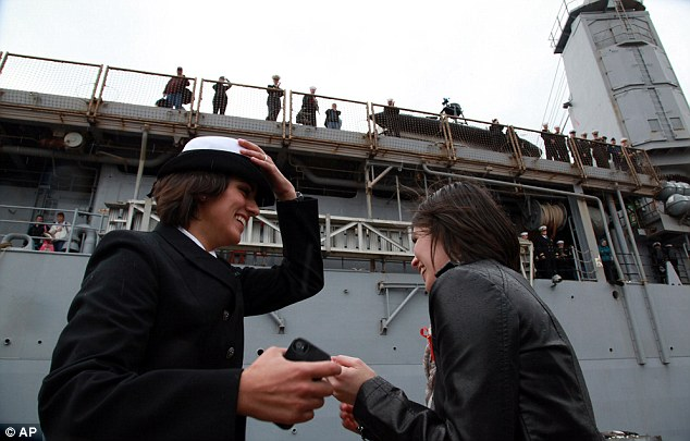 A first: The lesbian couple won the time-honoured tradition of the 'first kiss' for the first time in the Navy's recorded history