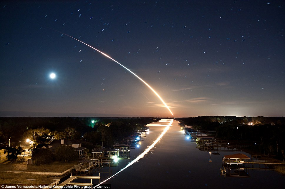 Soaring: Waterway to Orbit, by James Vernacotola, displays the Space shuttle Endeavour flying into orbit over the Intracoastal Waterway in Ponte Vedra, Florida