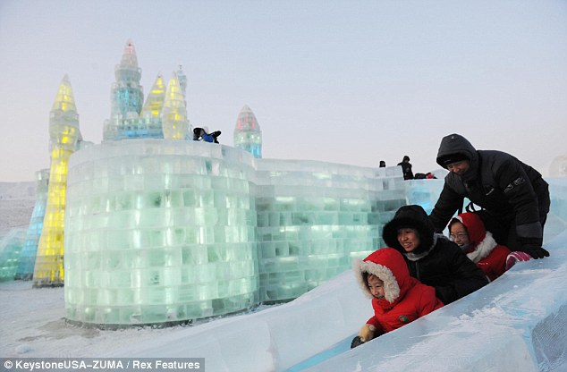 Winter fun: As well as sculptures, the festival also features a range of ice-based rides