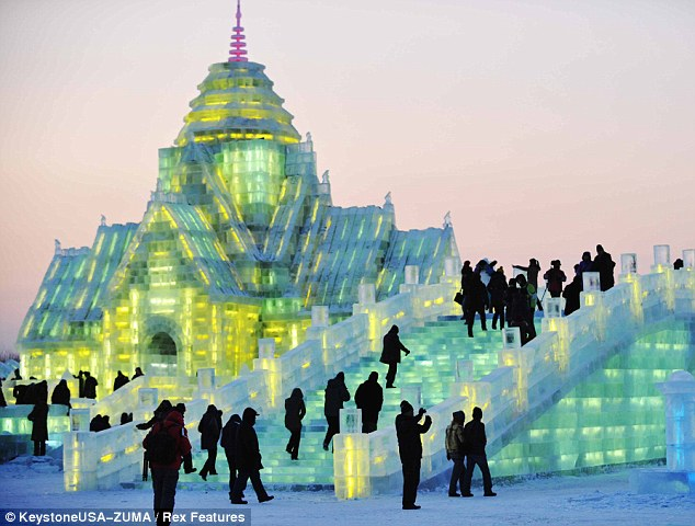 Slippery slope: Visitors are dwarfed by the giant ice architecture