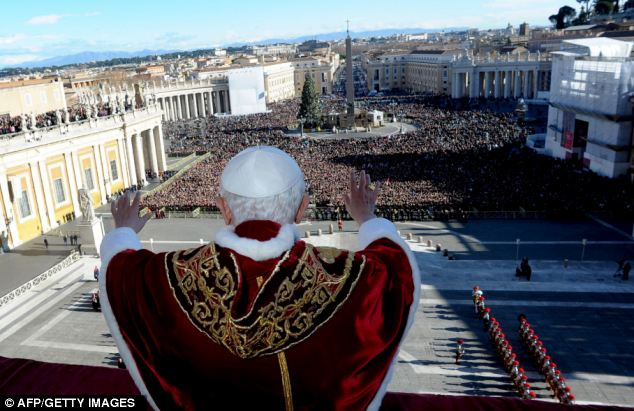 Worship: Thousands of worshippers converged outside the Vatican to hear Pope Benedict XVI deliver his traditional Christmas 'Urbi et Orbi' blessing