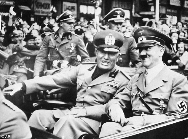 In Italy, the Fascist leader Benito Mussolini, pictured with Hitler, strengthened his grip, consolidating Italian power in the looted colonies of Albania and Libya