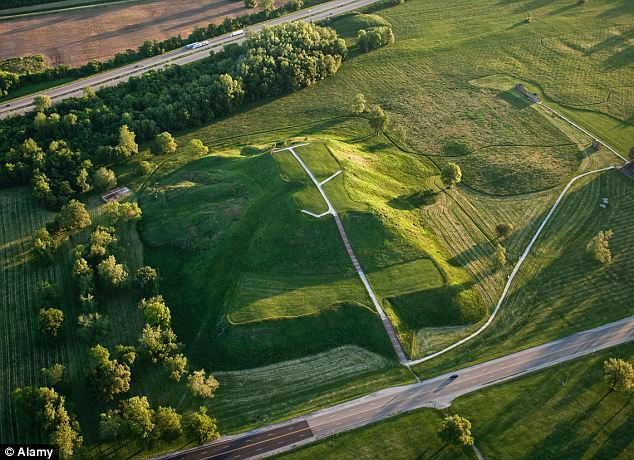 An aerial view of Monks Mound with tiny cars visible in the background reveals the site's scope