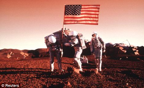 Red alert: Hawking believes that we will one day colonise our cosmic neighbour. Pictured is the Disney film Mission To Mars