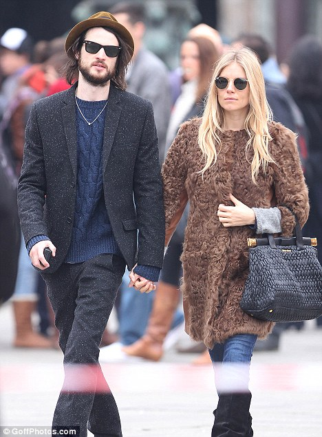 Expecting? Sienna Miller and boyfriend Tom Sturridge pictured here in November, have yet to officially confirm the news
