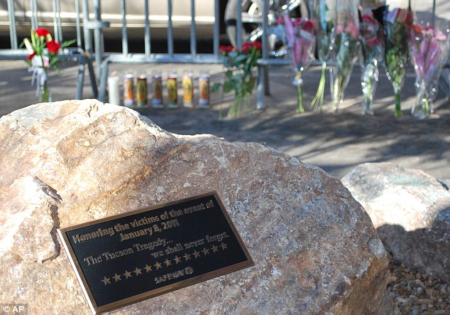 Forever honoured: A memorial outside a Safeway supermarket in Tucson where six people were shot dead and 13 others wounded a year ago