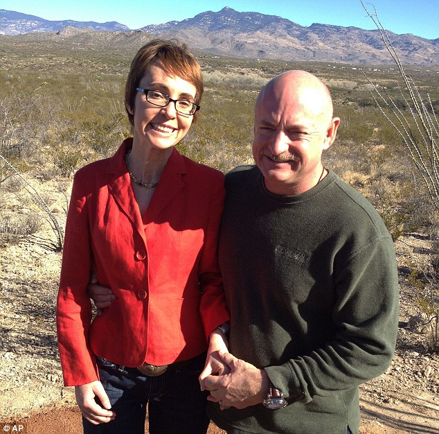 Back in Tuscon: U.S. Rep. Gabrielle Giffords on Saturday with husband Mark Kelly at the Davidson Canyon Gabe Zimmerman Memorial trail