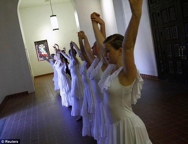 Honouring the dead: Members of the Tucson Dance Academy at the St Augustine Cathedral in Arizona