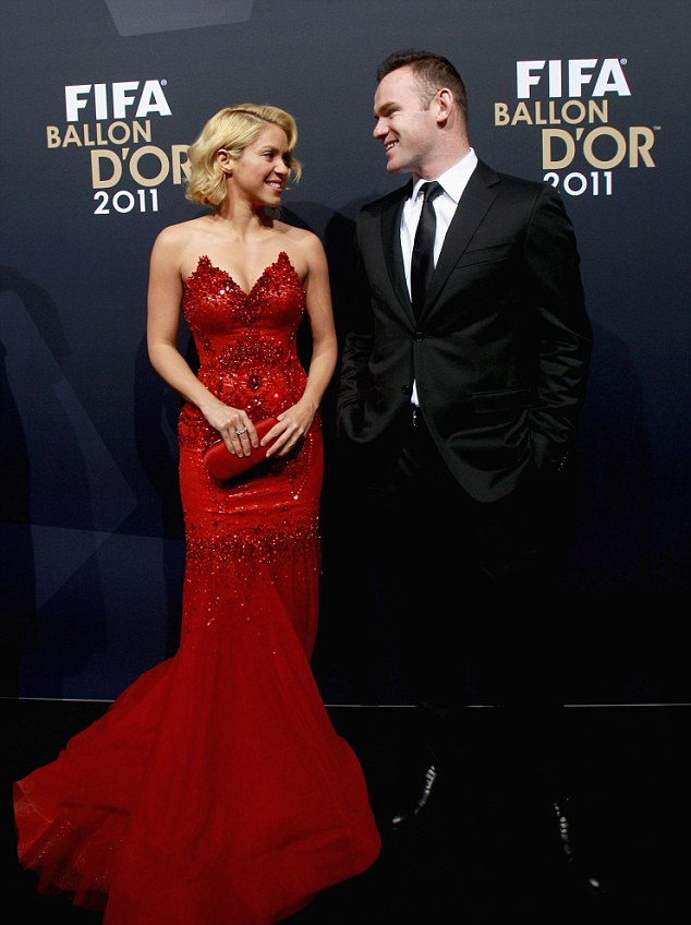 Come here often? Shakira and Wayne Rooney don't usually hang around in the same circles but they were all smiles on the red carpet at the Fifa Ballon D'Or in Switzerland on Monday