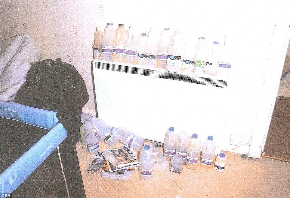 Shocking: Bottles of rotten milk in various states of decay line up along the top of a radiator near Declan's cot