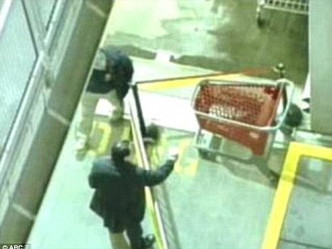 Investigation: Police seal off the crime scene and Target shopping cart which struck Mrs Hedges at Harlem Mall on October 30