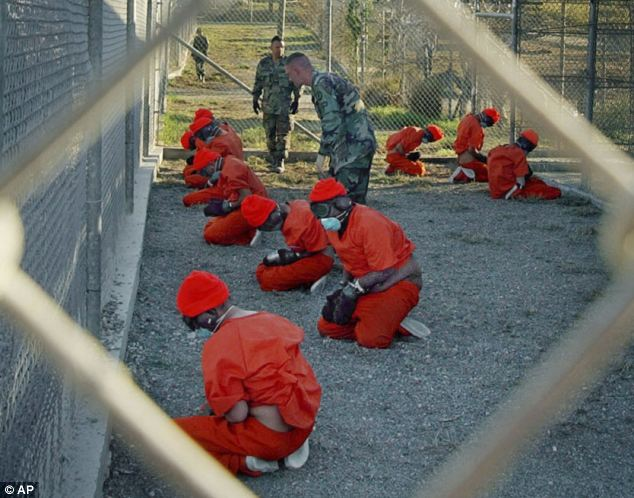 Detainees wear orange jump suits at Guantanamo Bay in 2002, the year after Aamer was detained there. They cannot hear, see or smell anything