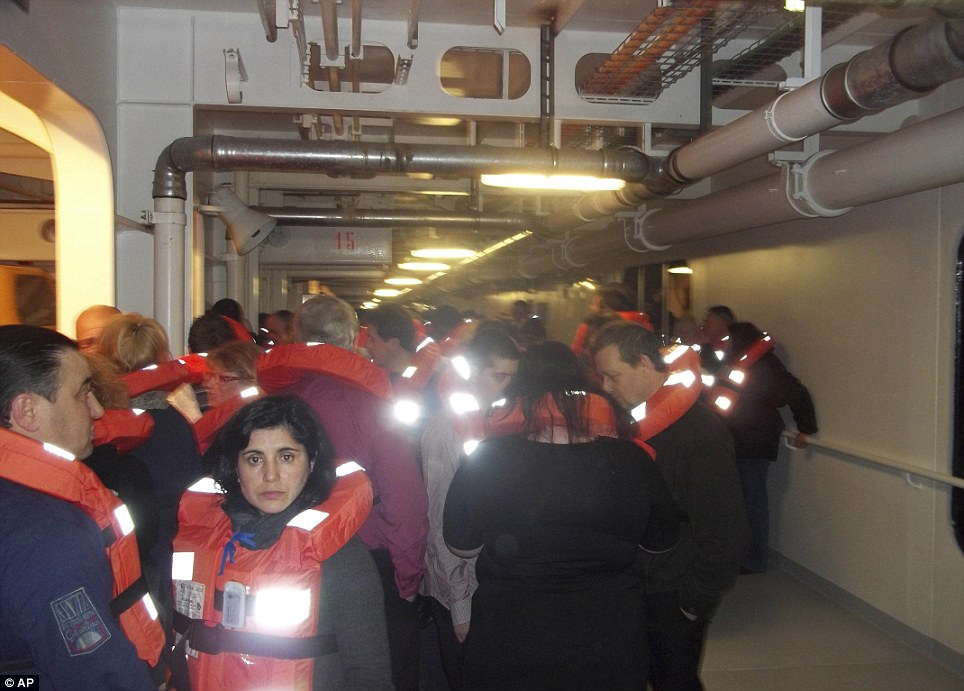 A passenger took this photo of a group of passengers in life-jackets on board the liner as they waited to be rescued