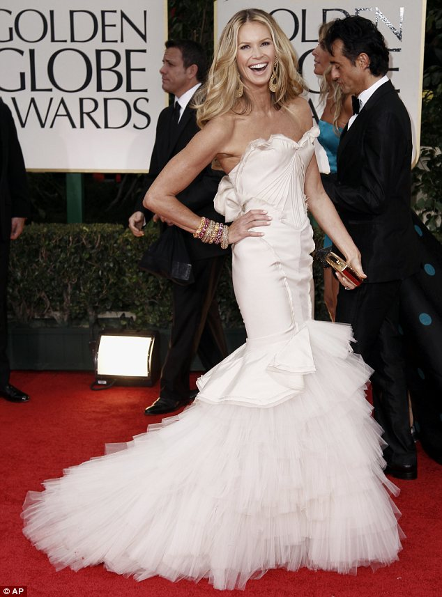 She's still the body: Elle Macpherson wore a dramatic strapless dress with layered fishtail train