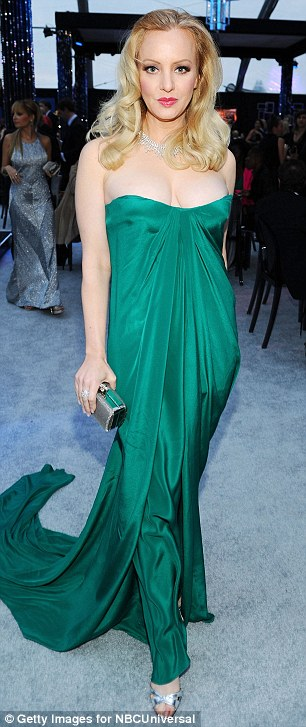 Mind you don't pop out! Bridesmaids star Wendi McLendon-Covey struggled to contain her cleavage in a low-cut emerald dress as she stopped for photos at the viewing party
