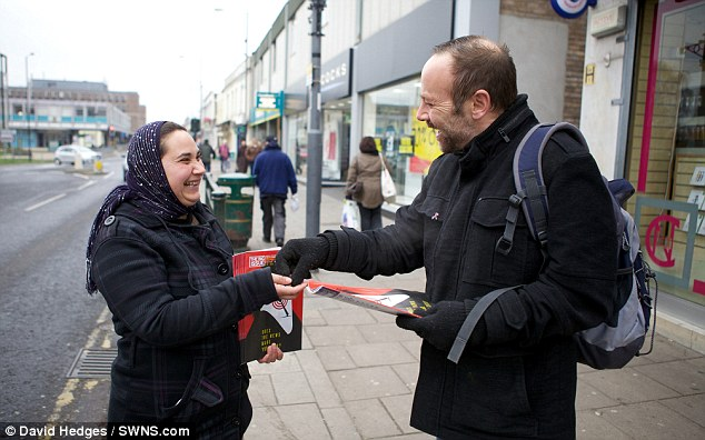 Helping hand: Vasile, who buys and sells the Big Issue from her own money, can now claim up to £20,000 a year