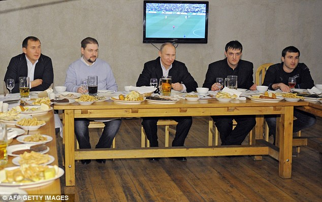 Pledge: Putin has promised a review of the current ban on the the sale and advertisment of beer at football matches