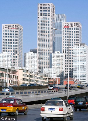cars head into the heaving city that his led the transformation of the country's economy