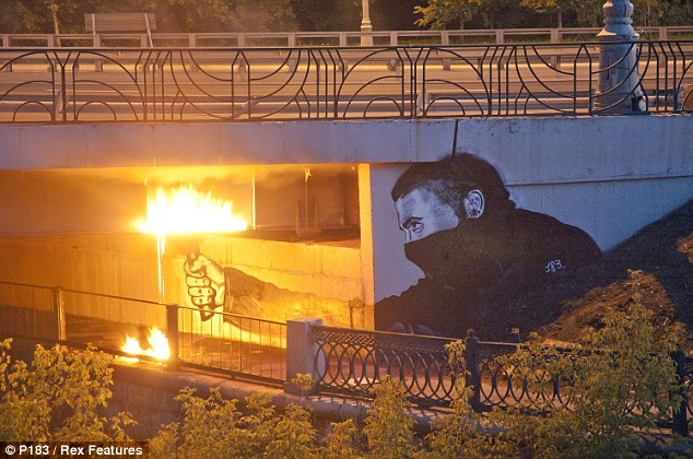 Inventive: P183's Instigators Of Bridges work depicts a rioter with a flare painted on a flyover. At night, real flames are lit to add realism to the piece