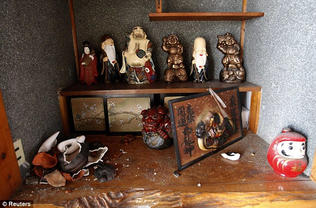 Deities: Dolls of the 'Seven Gods of Good Fortune' are seen inside a house damaged by the earthquake in March last year
